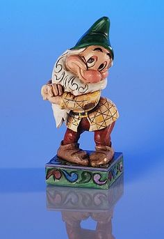 """Heartwood Creek by Jim Shore Disney Traditions  Snow White's BASHFUL  Specifications   Size: 4.5"""" H  Materials : Stone Resin.    Your Price: $18.00. Almost have all 7 dwarfs!!"""