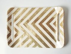 Show off your favorite hors d'oeuvres on this swanky chevron tray. Love me some chevron.