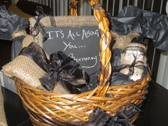 """This basket was based on """"all about you"""" theme, in the basket I included a bottle of Skinny Girl Margarita, the book 50 shades of gray, a mason jar filled with Jordan Almonds ( her favorite candy), a picture frame with a photo of her daughter and mine holding hands together, a spa hand treatment and a bouquet of flowers.  I also included a gag present which was a roll of toilet paper wrapped with a hand written poem. Enjoy basket idea, gift basket, spa"""