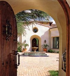 The Spanish mission revival style is recognized by:    •Simple stucco and adobe styled block exteriors and colorful clay tile roofs    •Elegant arches, walkways, and gables add unique Spanish flavor to the home's exterior    •Clearly defined geometric patterns and shapes throughout the design    •Coastal Mediterranean vegetation, including citrus and palms.