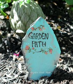 Garden path sign painted on slate.