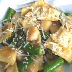 Scallops and asparagus sautéed in garlic, olive oil and butter tossed with cheese ravioliettes. Topped with Parmesan cheese.