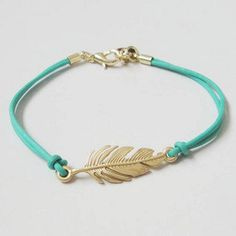 Gold feathers hand-woven bracelet, green. $3.00, via Etsy.