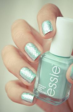 Interesting snakeskin nails. Turquoise and Caicos with silver snakeskin stamped over.