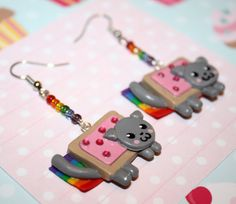 earrings by Etsy seller KillerCupcake Disclaimer: While I do have a mild obsession with the Poptart Kitty, I do not necessarily want all or any of the items I'm pinning here.