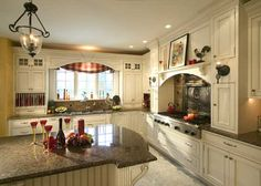 French country kitchen with antique white cabinets.