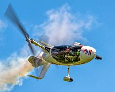 Autogyro performing at air show.