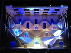 Nine. RCBC Theatre in Manila, Philippines. Set design by David Gallo. The two main design element is shape and composition. This is seen by the use of squares. There are squares on each platform and even for the lights to be shined through the ceiling. It also uses arches for the doorways. Everything is extremely symmetrical. This design is striking and impressive because of how symmetrical it is.