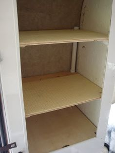 Shelves in the closet, made out of PVC pipes and plywood. Sturdy and brilliant.