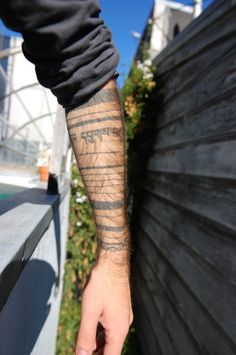 """The fountain"" like arm tatoo + words"