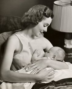 Breastfeeding in the 1950s | Community Post: 25 Historical Images That Normalize Breastfeeding Breastfeeding during a time when Western mothers were being discouraged from breastfeeding. This woman has rebel written all over her porcelain face, doesn't she?