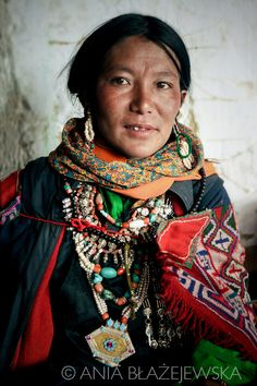 India, Ladakh.    Portrait of a woman from Korzok attending the local festival and wearing a traditional dress.  © Ania Blazejewska