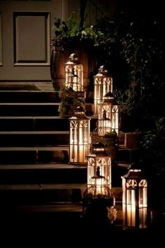 Light up your front steps with Lanterns filled with Luminara flame effect pillars. Major curb appeal.