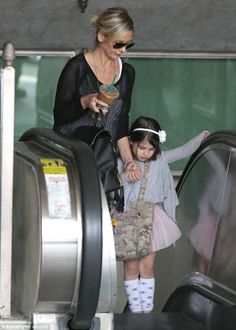 Mother-daughter day: Sarah Michelle Gellar held on tight to her mini-me Charlotte's hand as they rode the escalator on their way to dance class in Sherman Oaks, California on Saturday