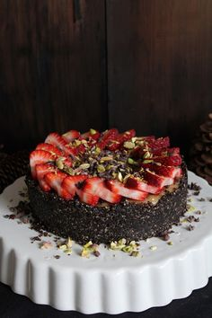 Vanilla Cheesecake with Chocolate Crust, Strawberries, Cacao Nibs and Pistachios from This Rawsome Vegan Life. Made entirely from natural, nourishing and delicious whole food ingredients including pecans, pine nuts, cashews, dates, shredded coconut, coconut oil and cacao. Full of essential healthy fats and fiber, as well as an array of vitamins and minerals.