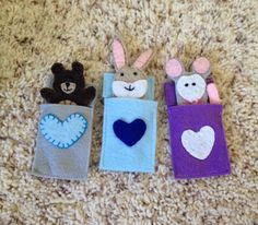 Finger puppet critters in their sleeping bags