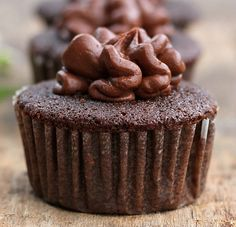 Homemade Chocolate Cupcakes and Frosting 12 decadent chocolate cupcakes with an equally delicious homemade frosting. The recipe can also be made into an 8 inch chocolate cake. You can't beat homemade!  #homemadechocolatecupcakes #homemade chocolatefrosting