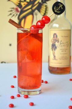 Red Hot Pin-Up with Red Hot Candy Infused Spiced Rum, Ginger Ale, Grenadine, Maraschino Cherries & Cinnamon Stick Garnish