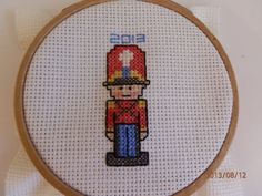 soldier cross, cross stitches, toy soldier