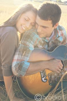Love the guitar and pose for this save the date engagement session.