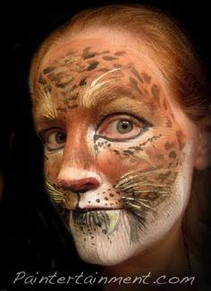 My first leopard, 1st attempt using a rake brush, and a cool new leopard print stencil! #facepainting #face #paint #painting #cats #leopard