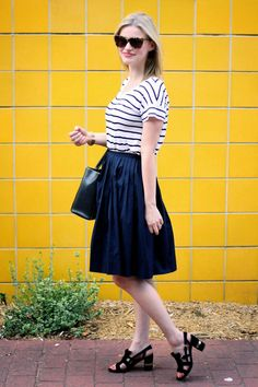 Blogger Elements of Katie pairs a Gap striped tee with a full navy skirt for a night out.