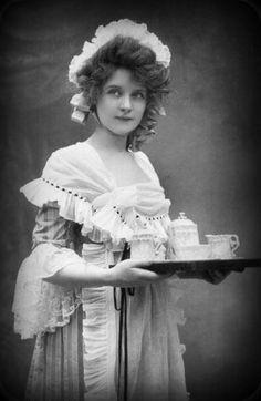 Billie Burke serving tea