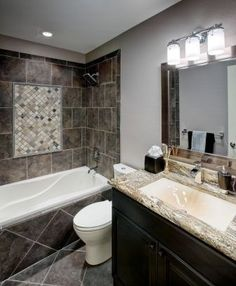 Like the color of the bath tile with dark cabinets and a blue wall