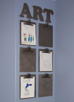 Love this idea for hanging kids school work - I need to find a place to do this in my house!