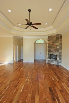 """This home features a wood burning fire place and gorgeous """"Tobacco Road"""" acacia wood floors."""
