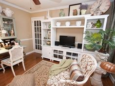 LIVING ROOM WITH WHITE ENTERTAINMENT CENTER