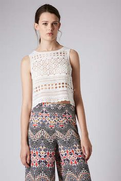 Here's the top Jennifer Lawrence is wearing -- Sleeveless Crochet Vest from Topshop