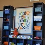 Three bookcases screwed together.  Makes a cool bench with cubbies.  I really like that alphabet wall, too.