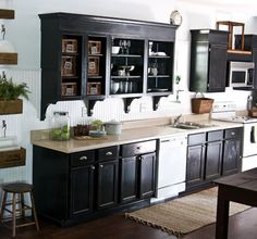 beach candy kitchen with black cabinets and wood floors - Google Search