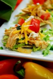 Mini Chicken Nachos - Corn chips will never be the same once you try this healthy recipe for mini chicken nachos. This healthy chicken filling and these tasty toppings work great in corn taco shells too. #hearthealthy  #glutenfree