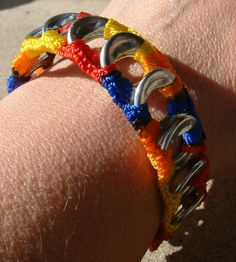 ReCycladelic Upcycled  Pop Top Bracelet Bold Rainbow in Red Orange Yellow and Blue Soda Can Pop Tab Jewelry. $6.50, via Etsy.