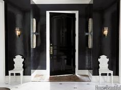 Lacquered walls bring drama to this foyer.