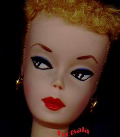 A number 1 Barbie,  hand painted, from the collection of Gene Foote.