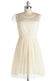 Celebrate your big day in this pleated, ivory frock, and you'll radiate elegance from your netted fascinator to your lilac heels!