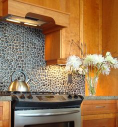Black Pebble tile backspash in kitchen-