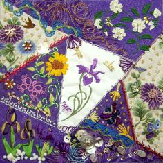 I ❤ crazy quilting & ribbon embroidery . . . This is Judy's block. I added the purple irises in silk ribbon on the lower left and a button trail to the right of that. I added six dragonfly charms, a butterfly bead and a bee charm to the rest of the stitching.