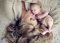 sweet mom and newborn pose