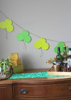 Shamrock Garland- Modern, geometic design makes this St. Patrick's Day craft stand out. An unexpected look for a traditional project. shamrock garland, saint patricks day, stpatricksday decor, garland stpatricksday, st patricks day, patti, patrick craft, design, crafts