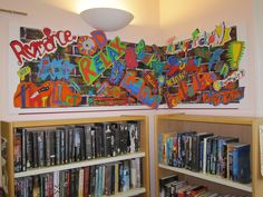 Mural in a library created by teens depicting what the library means to them.