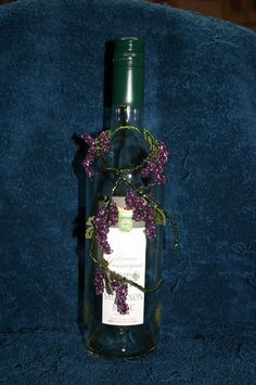 wine bottle with red grape clusters by BirgittasDesigns on Etsy