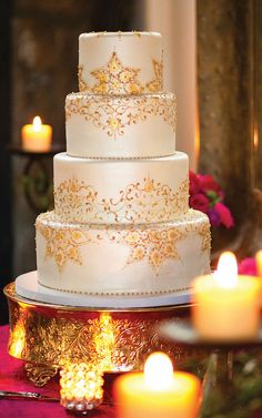 Sounds soooooo incrediably delicious...Wine Country Wedding: Vanilla Poppy Seed Wedding Cake, layered with White Chocolate Cream Cheese, Fresh Raspberry Purée and Tangy Lemon Curd decorated in fondant and glittering gold designs.