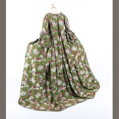 Back view, French open court robe, c 1750, French. silk damask with a woven floral and ribbon design worked in shades of green, pink and cream to a background of shot green and pink, with a sack back, underskirt, and a later made stomacher out of a piece of the same fabric, weighted sleeves, drawstrings over the panniers sides, with fly braiding and small ribbon flowers decorating the robe and underskirt, the lace on the neckline is of a later date. Boham's.