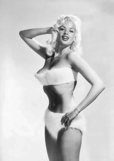 Jayne models a fur bikini, 1957.