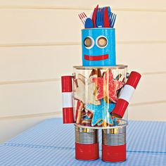 Robot helper -  recycled-can head holds utensils, and a clear container belly keeps cookies safe from eager little hands until it's time for dessert.
