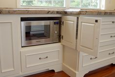 Hide microwave in cabinet.